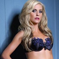 Claudine Keane models in Yuletide lingerie for Ultimo