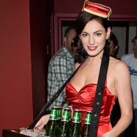 Kelly Brook dons 50s-inspired hot red jumpsuit to promote Carlsberg